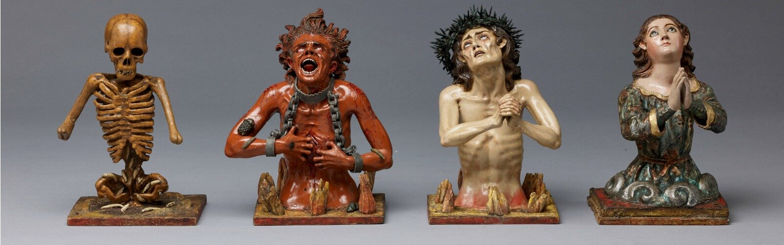 "Attributed to Manuel Chili, called Caspicara (circa 1723–1796), Ecuador, ""The Four Fates of Man: Death, Hell, Purgatory and Heaven,"" circa 1775, polychromed wood, glass and metal, Courtesy of The Hispanic Society of America, New York."
