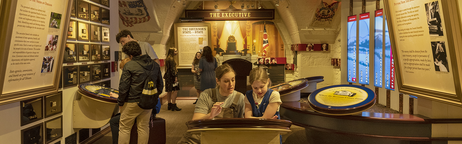 Monica and Bailey Craven explore interactive exhibits at the Ohio Statehouse Museum Education Center.
