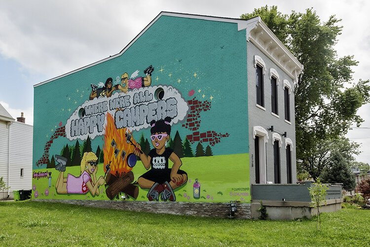 Visitors are greeted with a mural depicting the town's past and present.