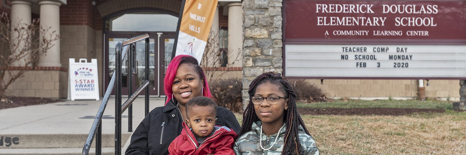 Sowonie Kollie and her children outside of the Frederick Douglass school in Walnut Hills.