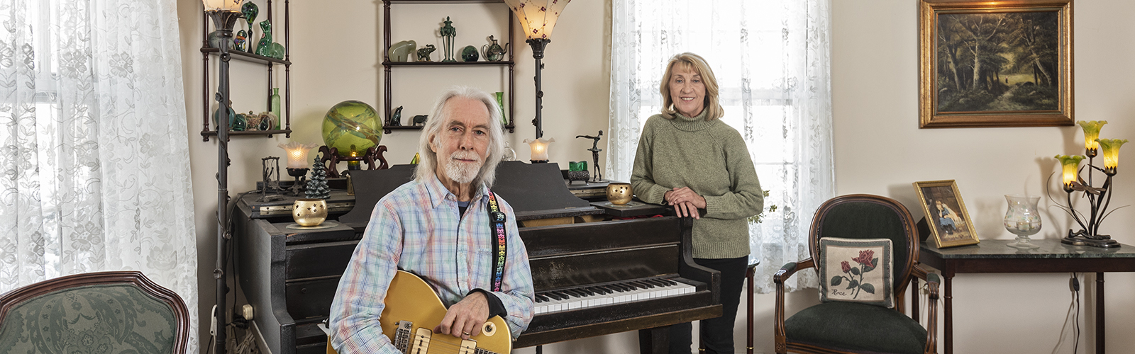 Gerald Parker, a singer and guitarist with Haymarket Riot, and his wife Susan at their New Richmond farm. <span class='image-credits'>Gary Kessler</span>