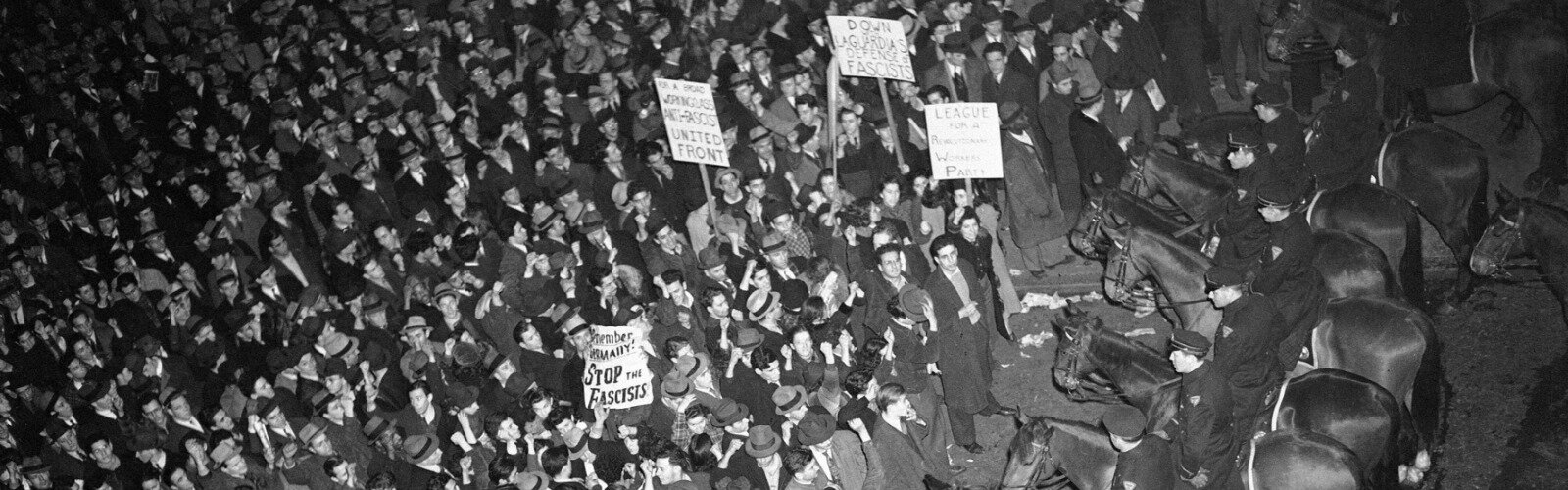 In 1939, New York's mounted police form a solid line outside Madison Square Garden to hold in a crowd that had packed the streets around the venue where the fascist German American Bund was holding a rally.