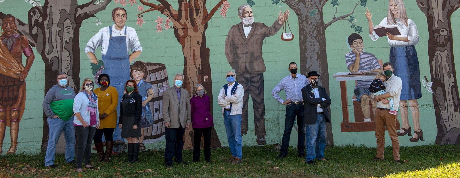 Westwood community organizers in front of the mural that started it all: John Eby, Jess Thayer, Portia Schandorf, Leslie Rich, Greg Kissel, Liz Kissel, Bill Fussinger, Dan Owens, Greg Hand, and Tom Sauter.