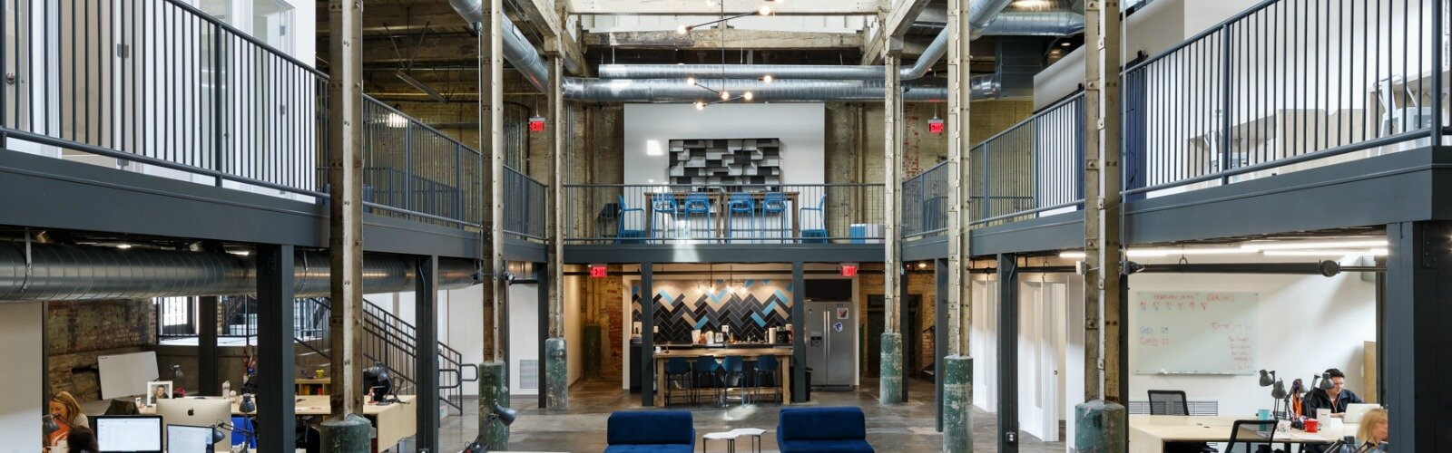 WorK SuperFanU offices demonstrate an adaptive reuse of a historic structure.