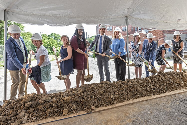 Community leaders at the groundbreaking of the old Manse Hotel.