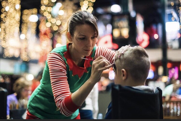 Kids can get their faces painted by an elf.