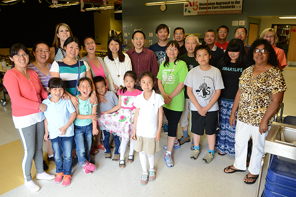 Families who participated in the Toyota Learning Center program celebrate the school year's end