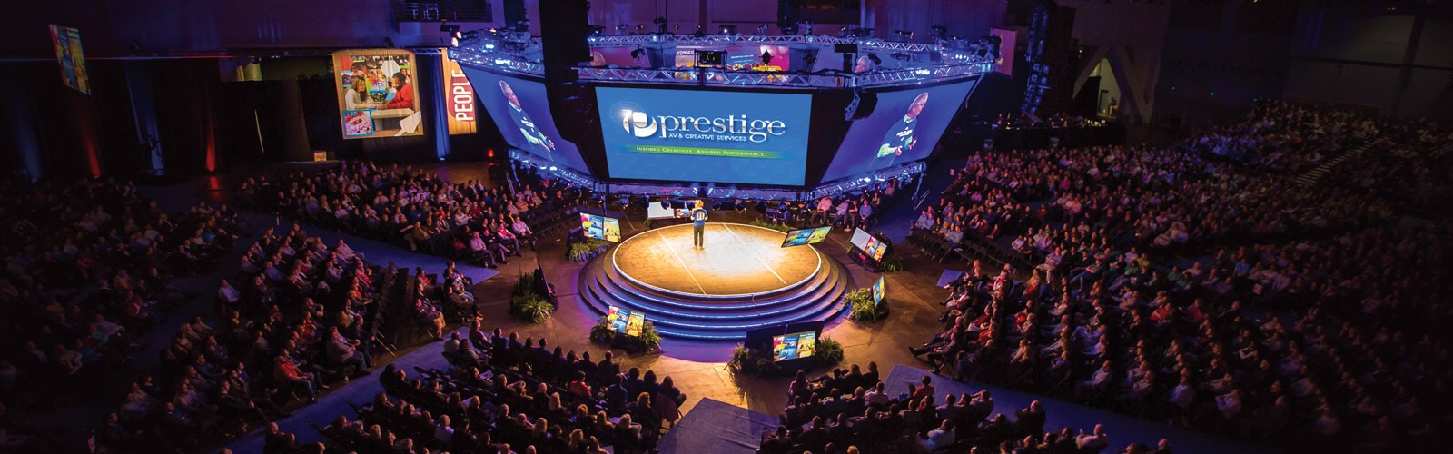"Prestige AV & Creative Services supports corporate meetings of all sizes including this ""in the round"" multi-screen set for 4,000 attendees. <span class='image-credits'>Provided</span>"