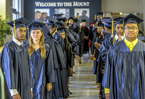 Jabril Bryant (front left) and his classmates comprise DePaul Cristo Rey's first graduating class