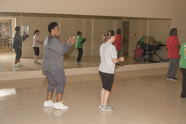 Bush Recreation Center's Vanessa Henderson (left) leads a dance-fitness class.