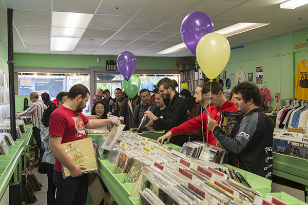 "Record Store Day shoppers browse ""special release"" vinyl."