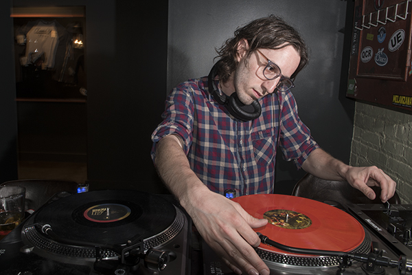 Local DJ Yusef Quota spins records at Queen City Radio.