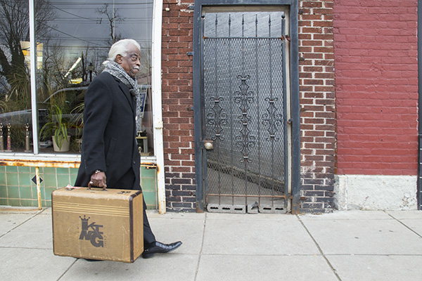 "Philip Paul with one of Xavier's ""traveling suitcases"" of educational materials about King Records"