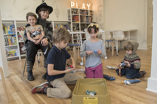 Children interact together at the Play Library.