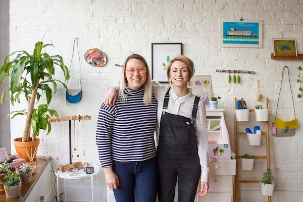 Suzy Strachan (left) and Brittney Braemer, co-owners of stationery shop Handzy in Covington.