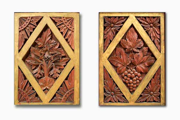 Two preserved carved wood panels from Music Hall's original organ.