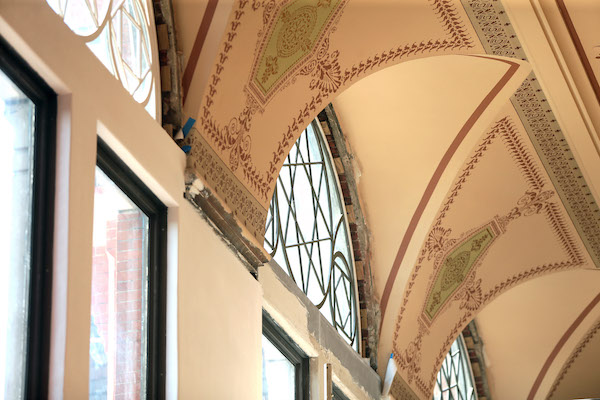 These windows, just below Music Hall's iconic rose window, were once covered over with bricks.