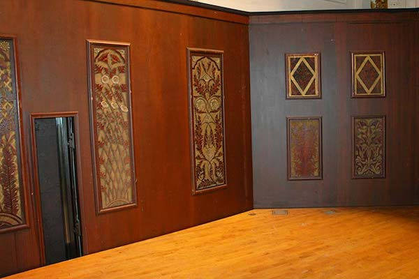 Eighteen carved panels from the original Hook & Hastings organ were hung in the orchestra pit.