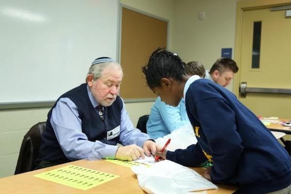 Students and mentors interact during an EC program in Bond Hill.