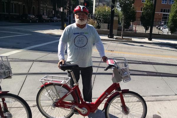 Queen City Bike's Frank Henson poses with a Cincy Red Bike.