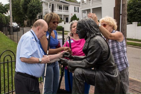 Visually impaired residents take part in a nano-grant funded art walk.
