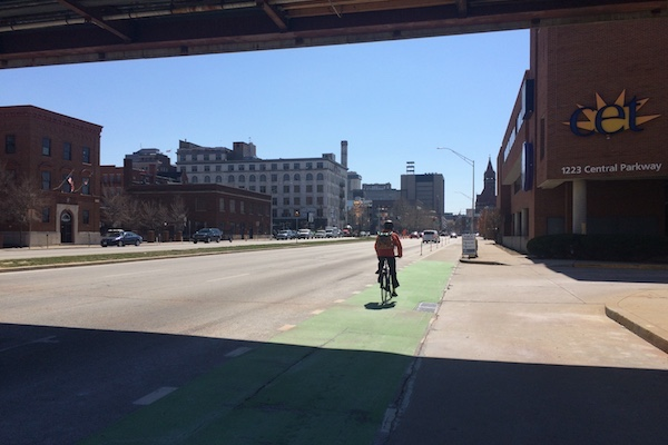 Protected bike lanes on Central Parkway still must contend with heavy car traffic in some areas.