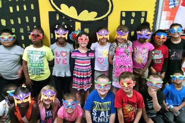 Children dress as superheroes at Covington's John G. Carlisle Elementary.