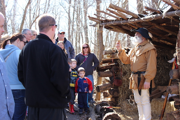 Guests enjoy a demonstration as part of Maple Sugar Days at Farbach-Werner Nature Preserve in Colerain Township.