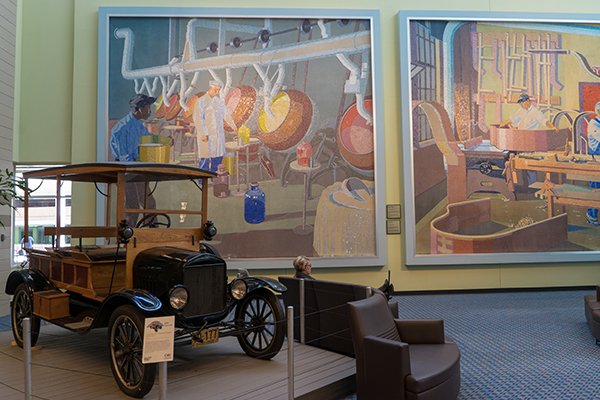 Pictured: Two of 18 mosaic-tile murals that call the airport home.