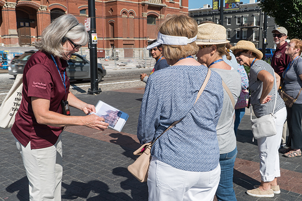 Guide Thea Tjepkema leads a walking tour of Music Hall's exterior.