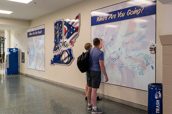 Interactive dry erase boards ask passengers where they're from and where they're going.