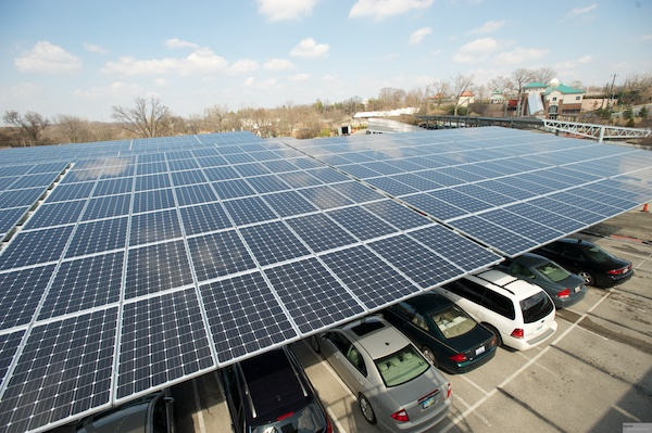 Solar panels provide shade for cars at the zoo's Vine Street parking lot and energy for overall zoo operations.