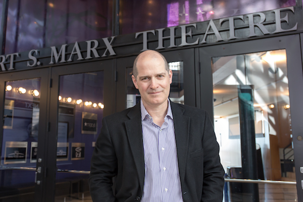 Blake Robison, artistic director for Playhouse in the Park, stands in front of the Marx Theatre, which will be demolished at the close of the 2018-2019 season.