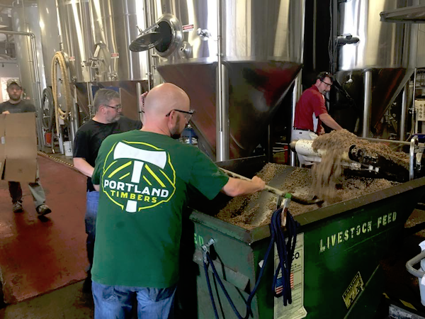 The BREW 100 class working with MadTree brewers to remove the spent grain from Window Sill.