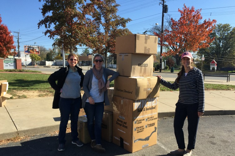 With the help of volunteers, Erin Fay (center) keeps tons of waste out of landfills.