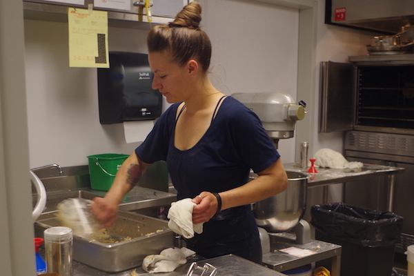 Sarah Dworak making pierogies in her commerical space at Findlay Kitchen.