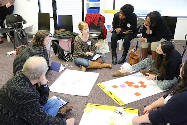 A group of nonprofits discuss their projects during last year's Studio C program.