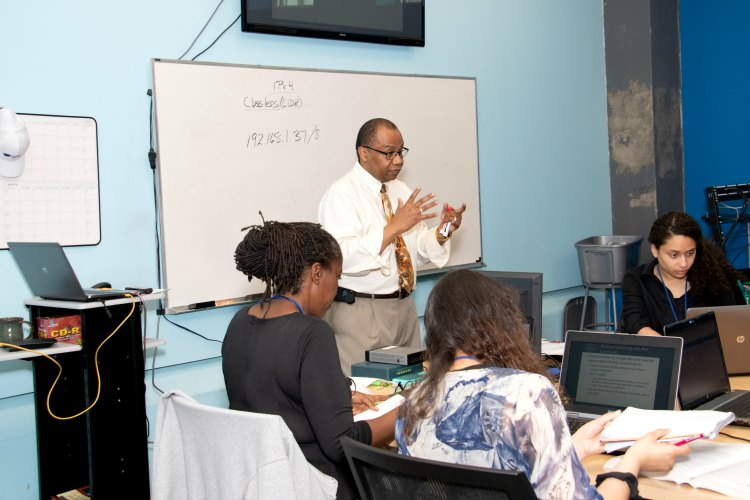 Delrae McNeill, Manager Technical Instruction, leads spring CompTIA A+ class.