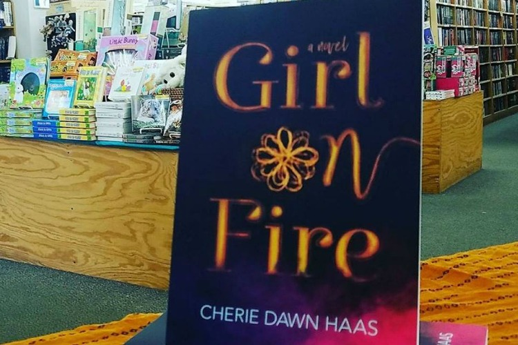 "Haas' debut novel, ""Girl on Fire."""