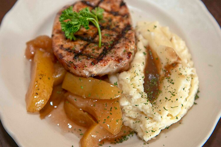 The tavern specializes in Southern comfort food, like pork chops and mashed potatoes.