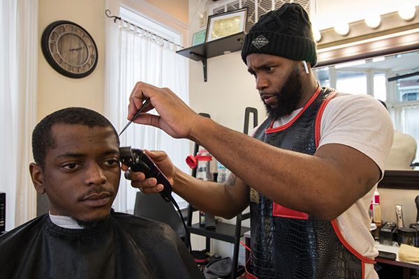Wale Giwa, owner of Upper Kutz, wants his shop to be a space for advancement, both for barbers and health professionals.