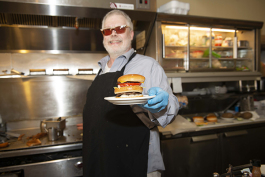 "Joe Tucker with ""Big Tucker Burger"""