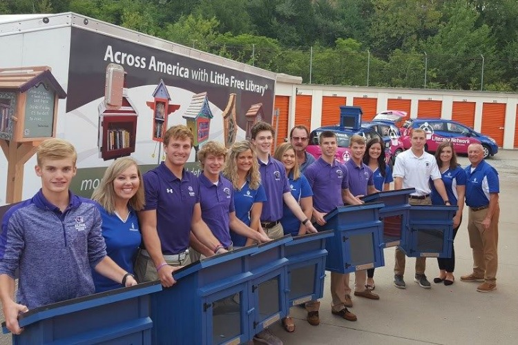Student volunteers from Elder High School helped unload and store the libraries.