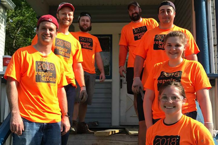Volunteers fix up houses for residents in need.