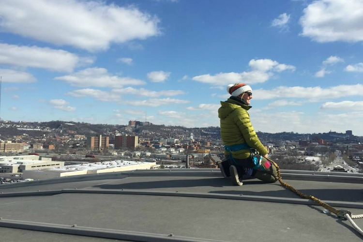 """National Parks Adventure"" film star and adventurer Rachel Pohl prepares to repel down from atop Union Terminal for the film's 2016 release in Cincinnati."