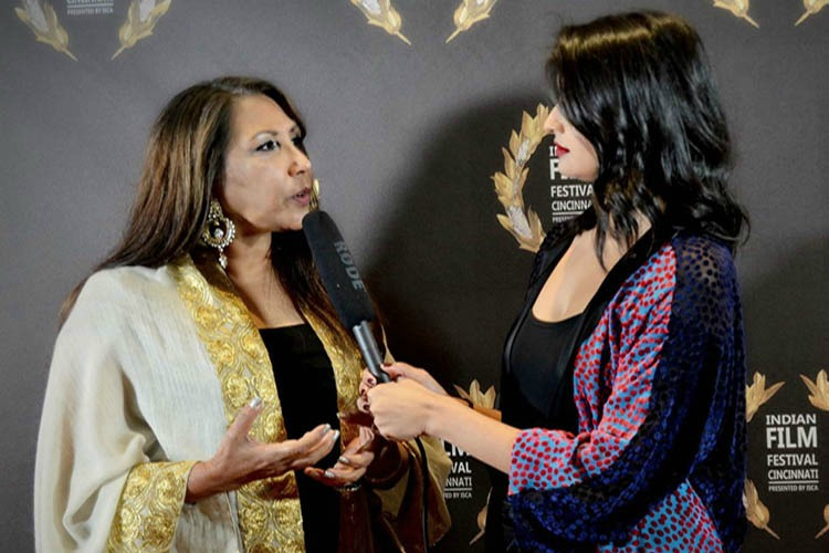 Ratee Apana (on left), executive director of the Indian Film Festival, interviewed by Menaka Apana