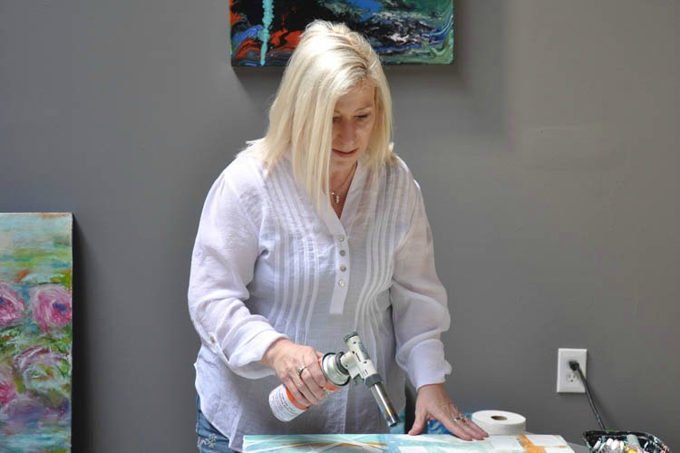 Shari Replogle doing her encaustic work in her second floor studio.