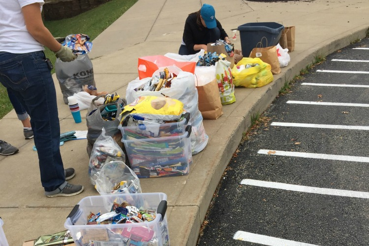 Pleasant Ridge families drop off their TerraCycling and Fay, with help, sorts it and sends it off.