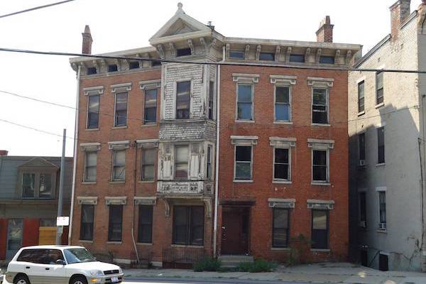 A developer acquired 1925 Vine St. through OTR A.D.O.P.T. and plans to redevelop the building into 20 residential units.