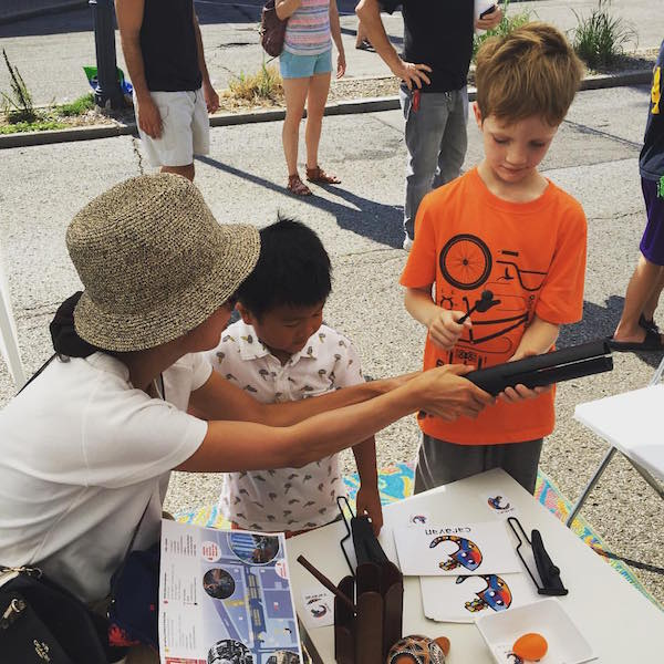 Kids test out different instruments at September's Art Off Pike. Caravan's next event is Ladyfest this weekend.